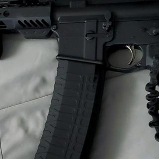 Fits nice, gets wider after leaving the mag well - Fits pretty nice for a 60 rd mag -