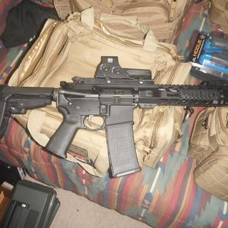 With flip-up sights and 512 optics