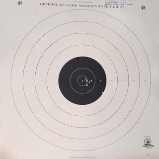 100 yard 4 shot group w/ 5th shot flyer from bench