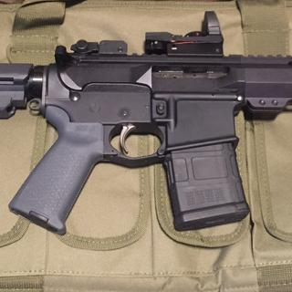 """7 """" nitride upper on an Anderson lower, with the SBA3 brace. Flip up BUS and a reflex sight."""