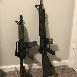 PSA 10.5 inch pistol, next to M16a4 colt clone.