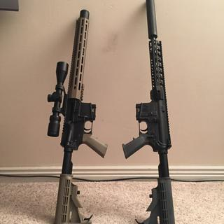 300 blackout on left 6.5 Grendel on right Quiet cans on both