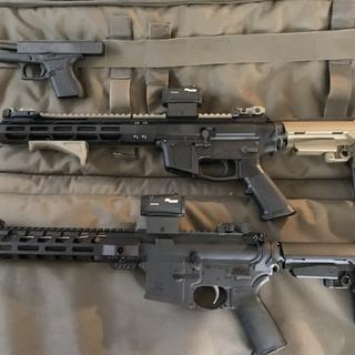The lower rifle is all PSA AR 15 build parts I put together for under 400. I luv this rifle💯💯