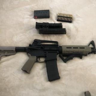 AR 15 pistol with 10.5 inch barrel. Carry handle rear sight and angled fore grip added