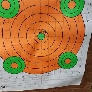 Three shot group on the right. Adjusted .2mils right and shot the last two.
