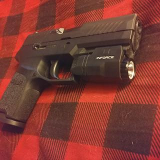 It fits my Sig Sauer P320 compact perfectly, without extending past the barrel.