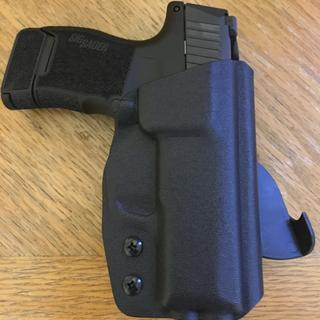 Fitted with a custom Multi Holster and 12rd magazine