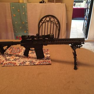 Added a comp and a bipod.  Ready for the range and some hunting.