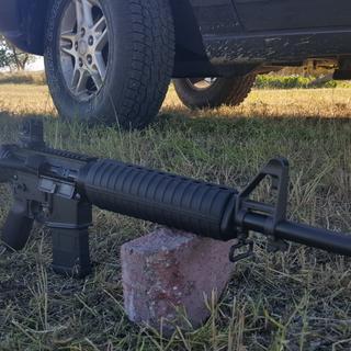 A1 stock and Daniel Defense rear sight. Feels better than carbine length or full length rail.