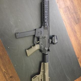 AR9 with Bushnell red dot and Glock 33rnd mag...