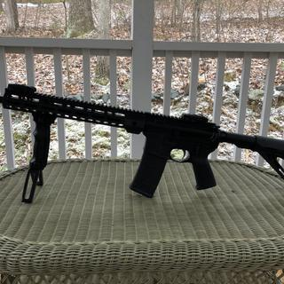 Added rail and Leapers UTG forward grip with deployable bipod.
