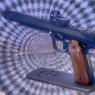 My competition gun, Ruger Mark IV  with all Volquartsen parts works flawlessly with Eley Force.