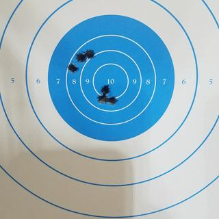 50 yds. High and left after bore sight but before adjustment