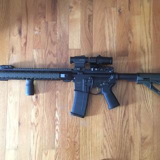 With OD green Magpul furniture.