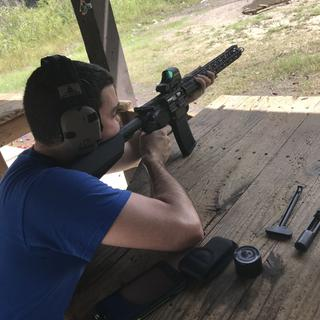 Shooting with the nickel boron BCG, standard BCG is on the table
