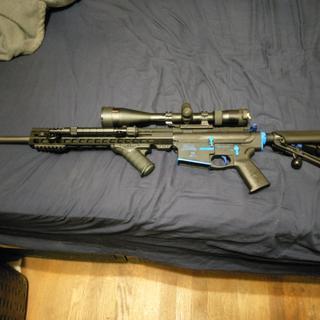 PSA upper and lower. Hyperfire 24e trigger, Nikon prostaff 5-20x40 scope, Adaptive Tactical stock.