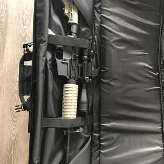 """Inside storage with 16"""" AR15 with scope and not fully collapsed stock"""