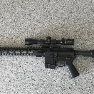 "18"" upper with PSA lower, Minimalist stock, CMC Flat trigger."