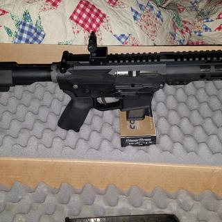 With a Glock mag extended