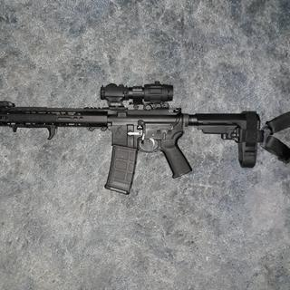 Magpul hand stop,mbus,at3 red dot and x3 magnifier.