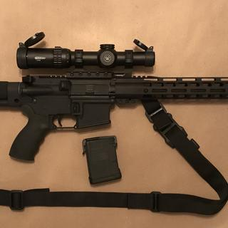 Paired with old bushmaster with a better trigger, long buffer tube and vortex strike eagle 1-6.