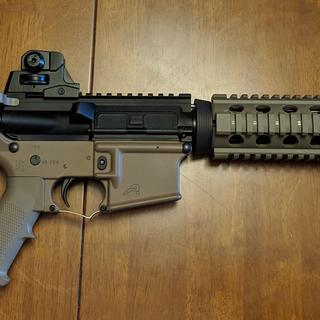 Added alum carbine length quad rail, rear sight, changed charging handle and trigger guard to fde