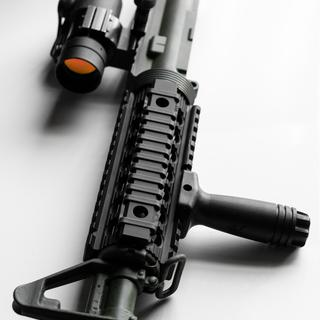 Pictured with aftermarket quad rail, red dot, and grip.
