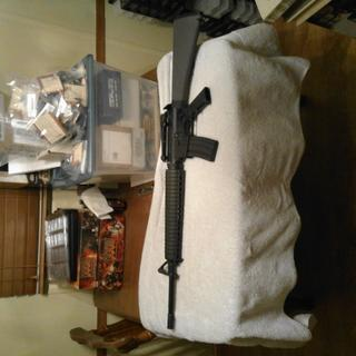 The complete black rifle. Please disregard miniature collection in the background.