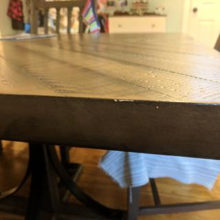 The finish on the edge of the table is coming off