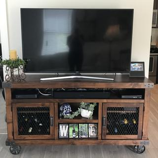 Love our new television stand!  Ended up fitting our wine, too!