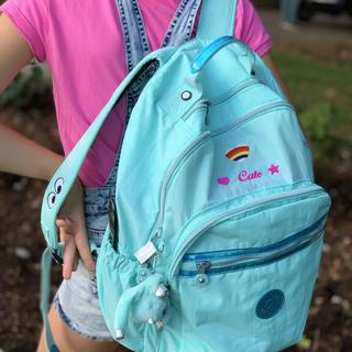 She loved customizing her backpack and parents love the quality and features of a Kipling product.