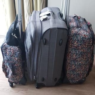 Shown in picture youri spin, one carry on and medium size kipling luggage
