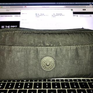 """My beloved 5-year-old, """"TRAVEL DOCUMENTS HOLDER Extra Large Wallet"""" in black."""