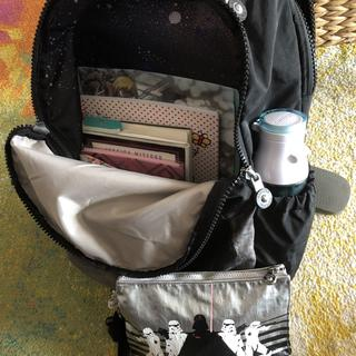 Cavernous main compartment holds a TON of stuff! And nice sized water bottle pockets!