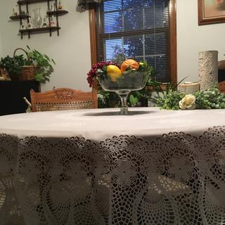 Love this tablecloth! Looks like a real crocheted tablecloth! Cleans up easily!
