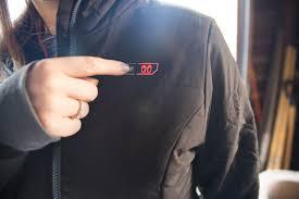 The 2nd button, with the hands pictured on it, is for the heated pockets on another jacket!