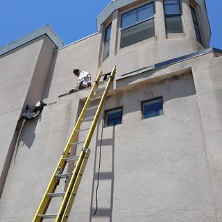 4 story cutting stucco for flashing