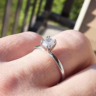 My .69 carat cushion cut diamond solitaire engagement ring