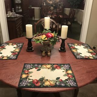 Table cloth is over a glass top. I still have my placemats and decorations on the table top