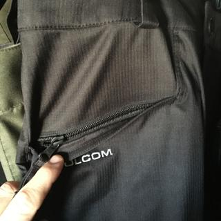 Front pockets have zippers back are Velcro