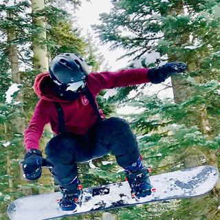 Flying through the air with his new snowboard