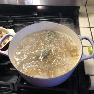 Boiling water for a one pot chicken Alfredo meal