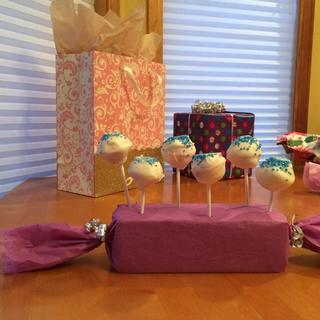 Some finished white pops with blue crystal sugar sprinkles