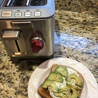 Toast with fresh mozzarella, avocado and Italian seasoning.
