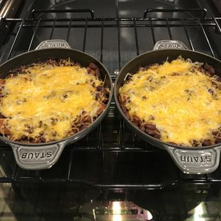 Oven baked chili with cheddar topping.