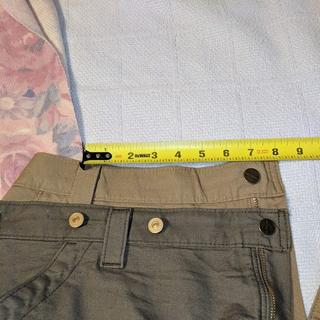 Misaligned belt loop right hand side.  Button 1/2 inch from the  edge, zipper. Pocket  top off