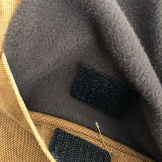 Velcro closure on right interior breast pocket.