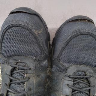 Toe shield separating from boot.