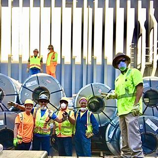ILWU Local 54 discharging steel coils