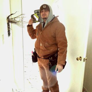 Carhartt jacket keeping me warm while changing a panel in cold weather!